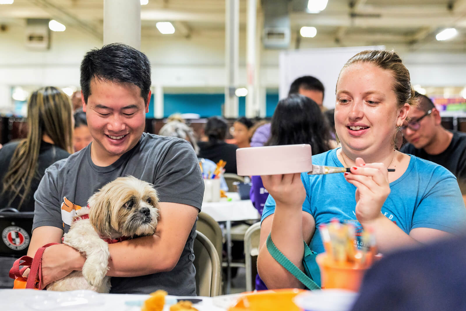 Sip and paint event people with dog painting dog bowl