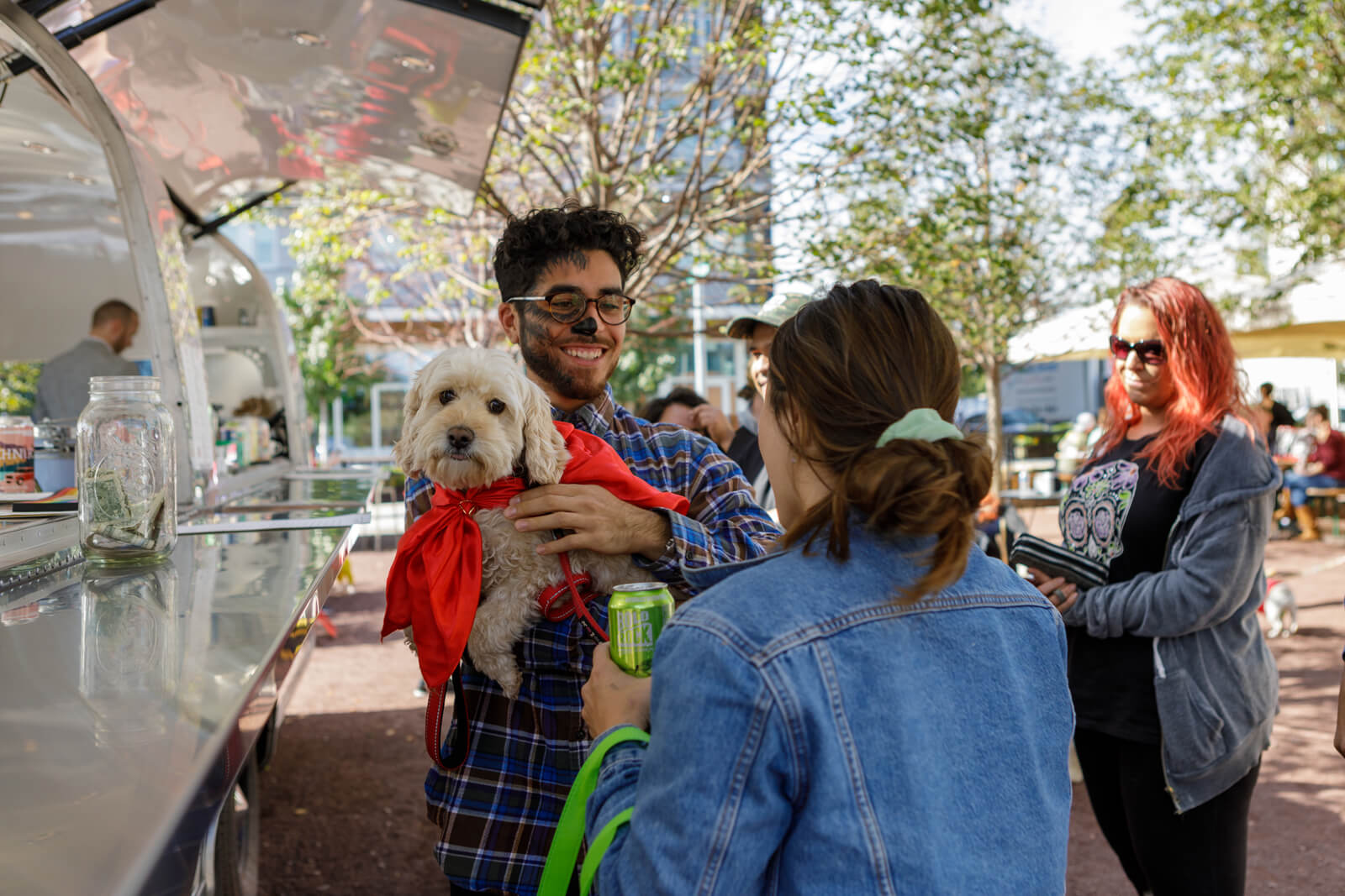 People and dog at Halloween event