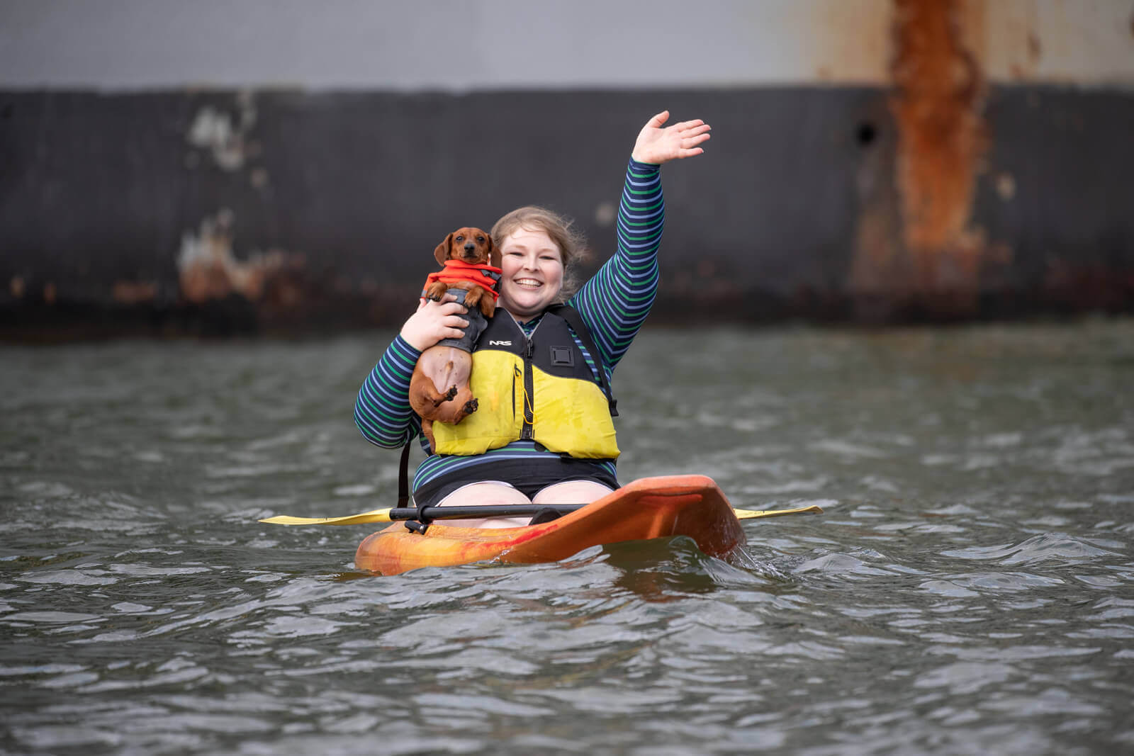 Women kayaking with dog